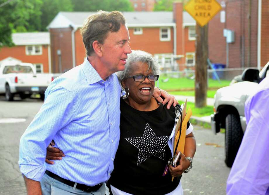 Ned Lamont and State Senator Marilyn Moore walk together through the Second Stoneridge co-op, during a campaign stop to visit with residents at the co-op on Yaremich Drive in Bridgeport, Conn., on Tuesday, June 5, 2018. Photo: Christian Abraham / Hearst Connecticut Media / Connecticut Post