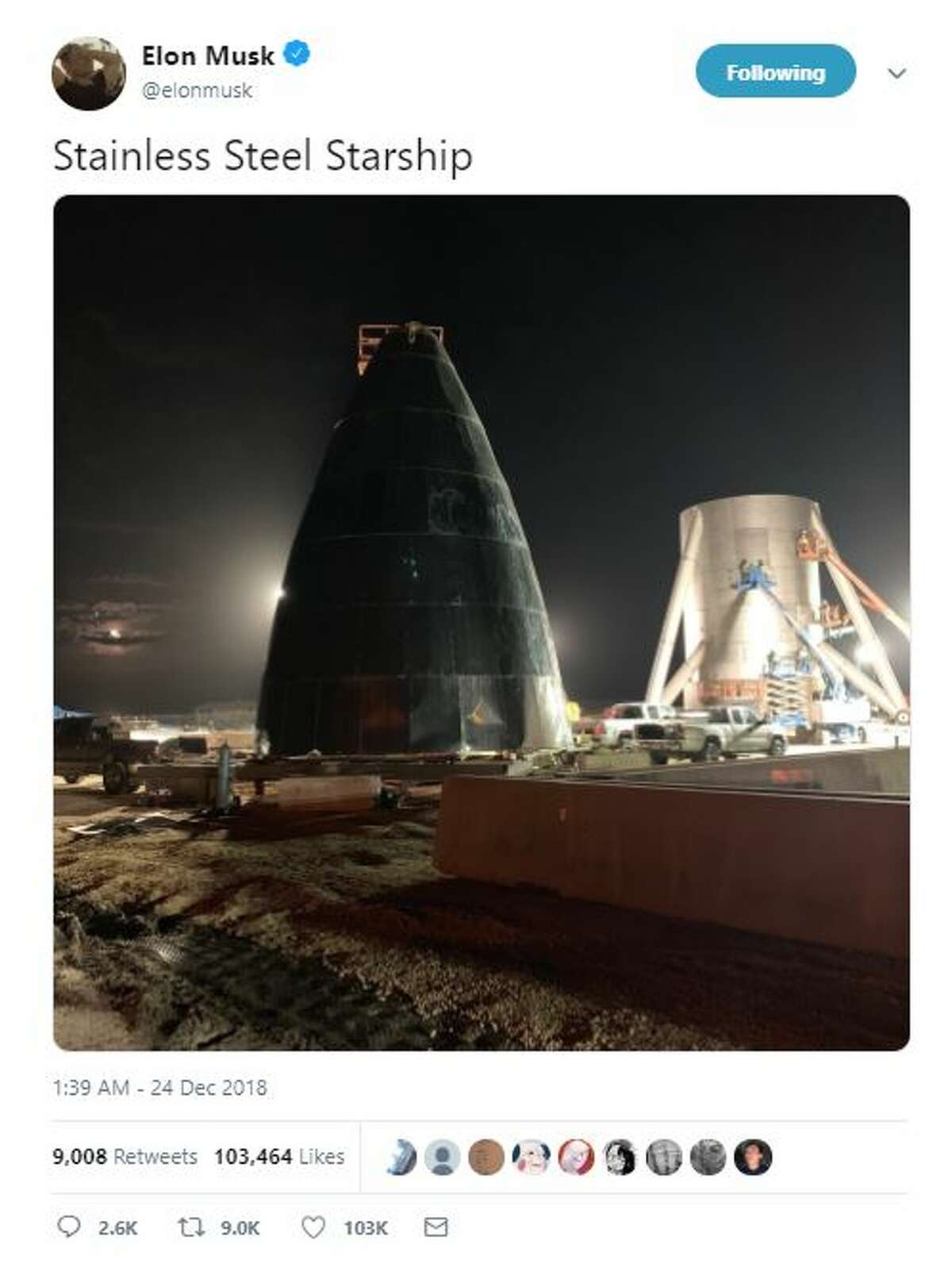 Musk's Twitter photo gives an indication of the scale of the prototype. Positioned next to a pickup truck, the nose cone appears to be multiple stories tall. Caption: