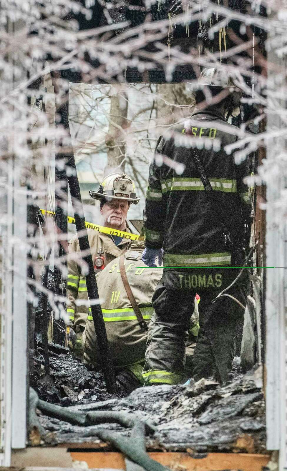 Fire investigators from State Fire try to determine the cause of a fatal fire at 23-27 Sarazen Way Wednesday Dec. 24, 2018 in Saratoga Springs, N.Y. (Skip Dickstein/Times Union)