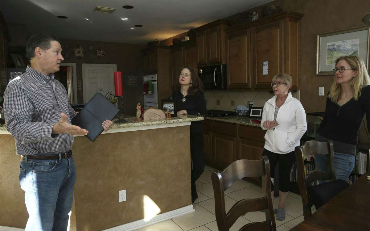 Dean Zebak shares what he learned from a Brazoria County Commissioner's Meeting in the morning with his wife, Jennifer Zebak, from left, and neighbors Debbie Sloan and Nancy Peskin on Tuesday, Dec. 11, 2018, in Pearland. CenterPoint Energy's recently built transmission towers in the Silverlake section has homeowners are worried about their property values and their health.