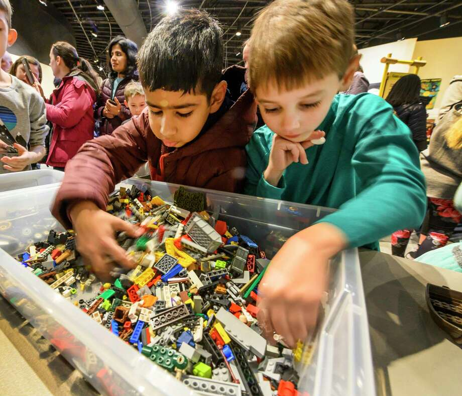 Kashyab Mair, 8, of Guilderland, left and Alex Kwiatkowski, 8, of Niskayuna check out some of the thousands of pieces on display on Lego Day at the miSci museum Wednesday Dec. 24, 2018 in Schenectady, N.Y.  (Skip Dickstein/Times Union) Photo: SKIP DICKSTEIN, Albany Times Union / 20045729A