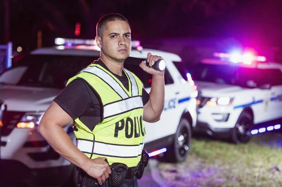 A man is proud for a job as a cop. Photo: Kali9/Getty Images