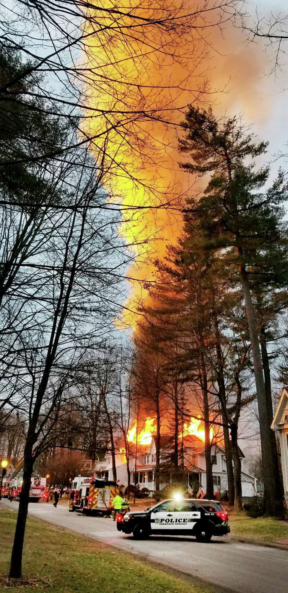 A column of fire rises from 23-27 Sarazen Way Wednesday Dec. 24, 2018 in Saratoga Springs, N.Y. (Special to the Times Union by Janine Rome)