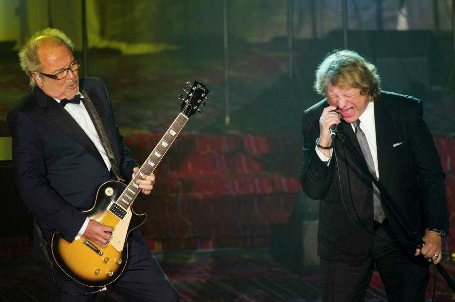 Mick Jones, left, and Lou Gramm from the band Foreigner perform at the Songwriters Hall of Fame 44th annual induction and awards gala on Thursday, June 13, 2013 in New York. (Photo by Charles Sykes/Invision/AP) Photo: Charles Sykes / Invision