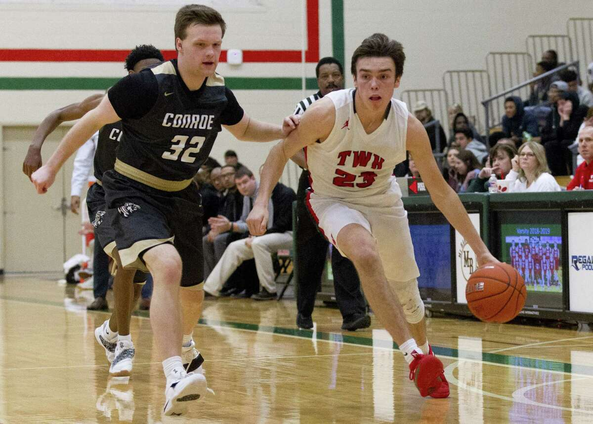 The Woodlands guard Cole Himmer (23) drives toward the basket against Conroe guard Kade Carnahan (32) during the third quarter of a District 15-6A high school boys basketball game at The Woodlands High School, Monday, Dec. 17, 2018, in The Woodlands.