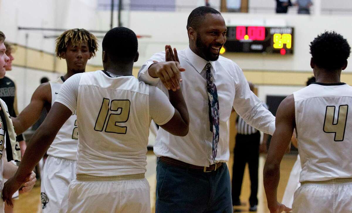 Conroe head coach Daryl Mason reacts after a buzzer-beater by guard Bryce Harris tied the game 59-59 during the first overtime period of a non-district high school basketball game at Conroe High School, Tuesday, Dec. 4, 2018, in Conroe.
