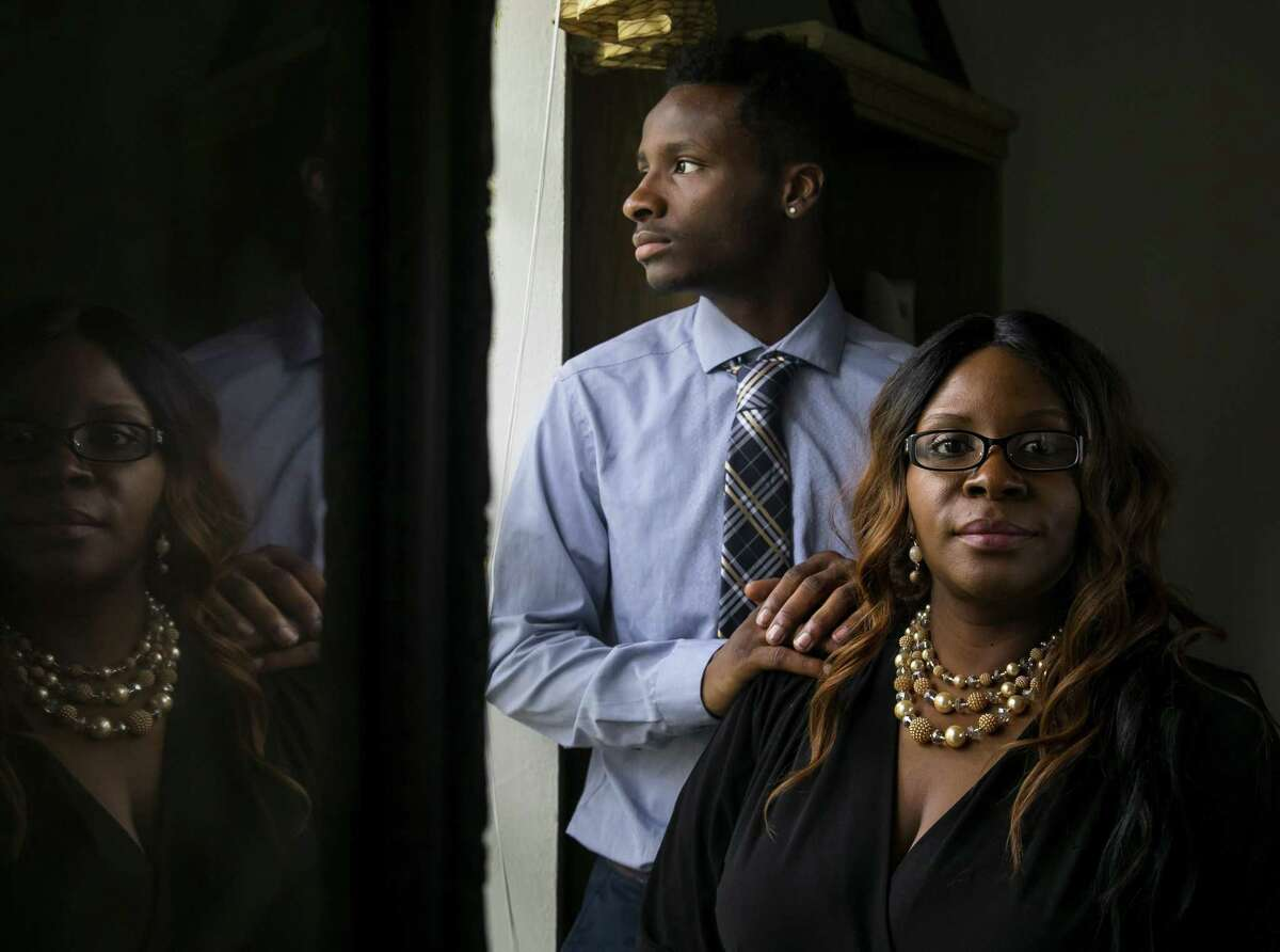 Trevon Thomas poses with his mother Toscha in their home on Tuesday, Oct. 16, 2018, in Spring.