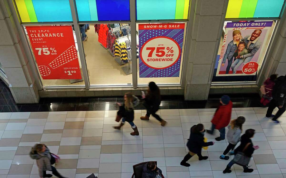 Shoppers make their way past the Old Navy store in Crossgates Mall on Wednesday, Dec. 26, 2018, in Colonie, N.Y. (Paul Buckowski/Times Union)