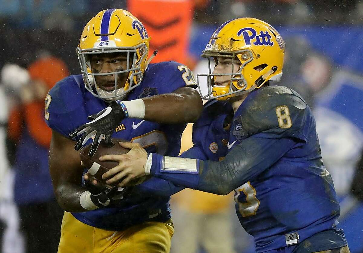 CHARLOTTE, NC - DECEMBER 01: Kenny Pickett #8 of the Pittsburgh Panthers hands the ball off to Darrin Hall #22 of the Pittsburgh Panthers during their game at Bank of America Stadium on December 1, 2018 in Charlotte, North Carolina. (Photo by Streeter Lecka/Getty Images)