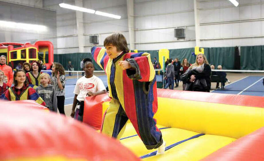 In this January 2018 file photo, kids enjoy various activities offered at the 15th annual Glen-Ed Last Night celebration. The upcoming event takes place from 6 to 10 p.m. on New Year's Eve, Monday, Dec. 31 at the Edwardsville YMCA's Meyer Center, 7348 Goshen Road. Photo: The Intelligencer