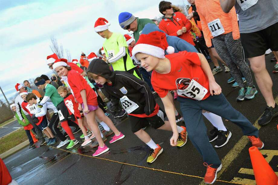 Christopher DeMuth, 10, of New Canaan, and others get ready for the starting gun at Grace Community Church's 6th annual 5K Santa Run, Saturday, Dec. 22, 2018, held at New Canaan High School in New Canaan, Conn. Photo: Jarret Liotta / For Hearst Connecticut Media / New Canaan News Freelance