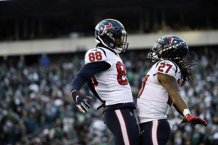 Houston Texans' D'Onta Foreman, right, and Jordan Akins celebrate after Foreman's touchdown during the second half of an NFL football game against the Philadelphia Eagles, Sunday in Philadelphia. Photo: Matt Rourke, STF / Associated Press / Copyright 2018 The Associated Press. All rights reserved