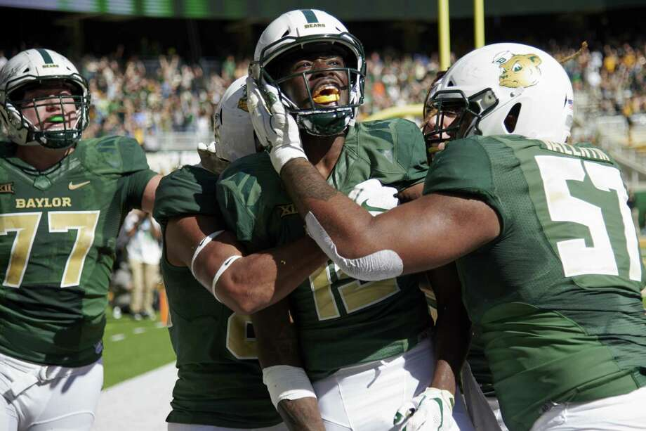 Denzel Mims (15) of the Baylor Bears celebrates with his teammates after scoring the game winning touchdown against Oklahoma State last month. Photo: Cooper Neill, Stringer / Getty Images / 2018 Getty Images