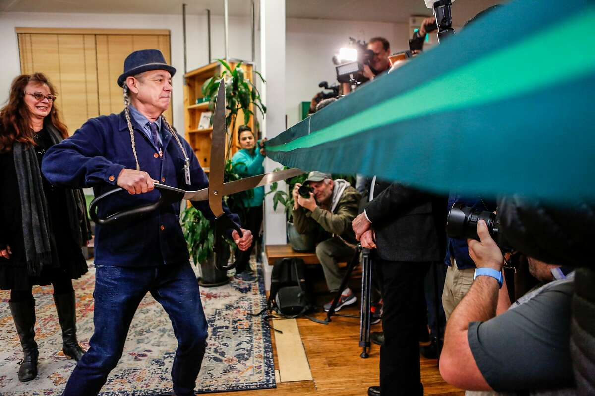 CEO of Harborside Health Center, Steve DeAngelo, cuts a ribbon at 6am to mark the first day of recreational marijuana sales in California on Monday, January 1, 2018 in Oakland, California.