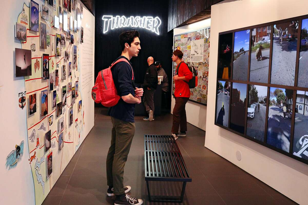 Nick Anaya (l to r) of Cool and Micah Whited of Auburn check out the video wall and art at the Thrasher flagship store at 66 6th Street on Friday, November 16, 2018 in San Francisco, Calif.