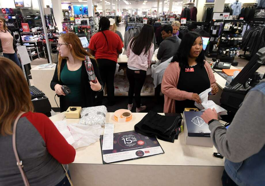 Arianna Gomez, left, and Treayanna Williams check out customers at JCPenny in Parkdale mall on Wednesday.   Photo taken Wednesday, 12/26/18 Photo: Guiseppe Barranco/The Enterprise, Photo Editor / Guiseppe Barranco ©