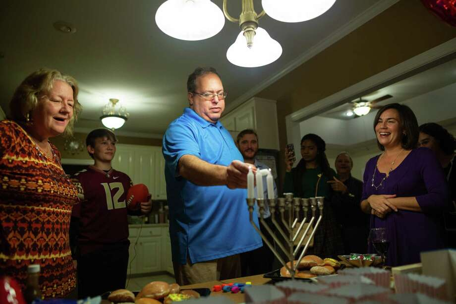 terence arenson lights a menorah in his home in dothan ala with lisa