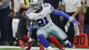 Dallas Cowboys running back Ezekiel Elliott (21) runs after a rececpiont against the Tampa Bay Buccaneers during the first half of an NFL football game in Arlington, Texas, Sunday, Dec. 23, 2018. (AP Photo/Michael Ainsworth)