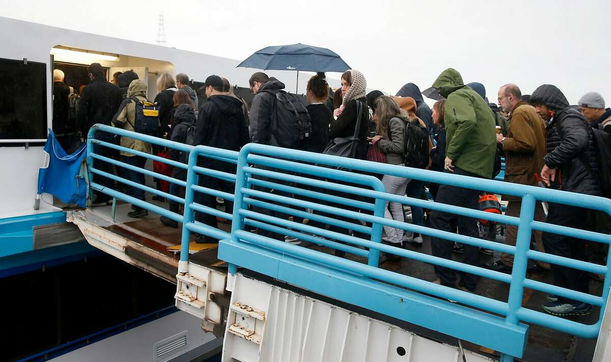 Commuters board a Golden Gate Ferry boat headed for San Francisco at the Larkspur Ferry Terminal in Larkspur, Calif. on Wednesday, Dec. 5, 2018. Ridership is up on ferry commuter routes prompting transit officials to revise schedules to accommodate the demand.