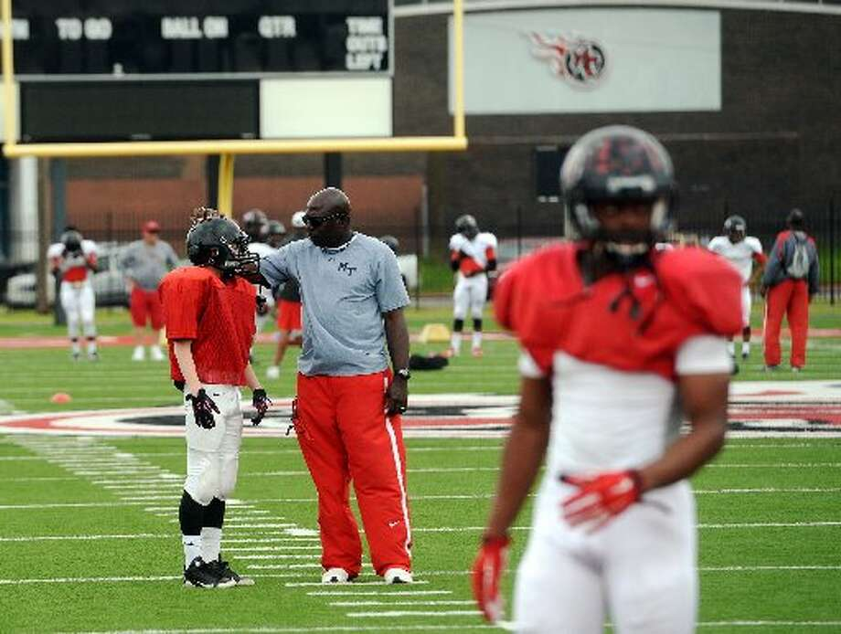 Kary Vincent, defensive backs coach, talks to a player during Memorial practice Tuesday afternoon. The Port Arthur Memorial Titans held their fourth practice of the spring at Memorial Stadium on Tuesday afternoon. Photo taken Tuesday 5/5/15 Photo: Jake Daniels/The Enterprise