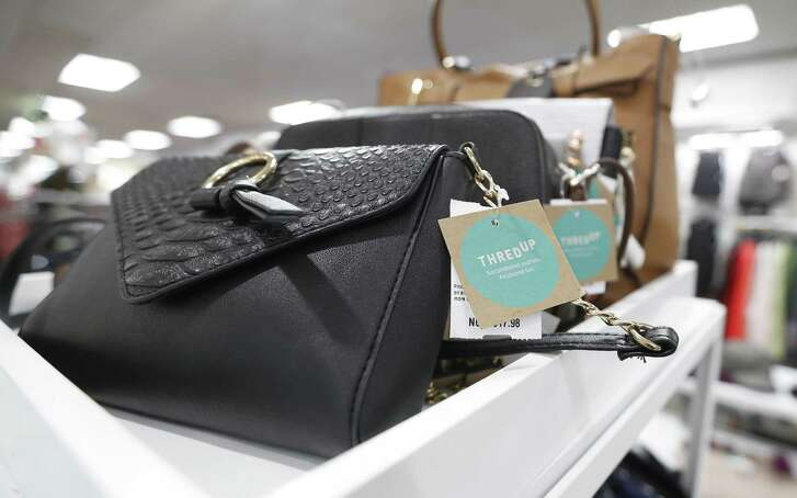 Detail of tags on handbags, used and gently-used for sale at the ThredUp pop-up shop inside of the Palais Royal store, Wednesday, Nov. 21, 2018, in Houston. The store-within-the-store offers second-hand clothing that appeals to shoppers who like to thrift shop.
