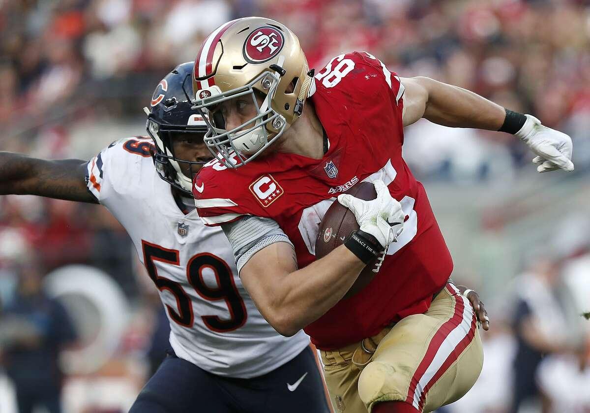 San Francisco 49ers tight end George Kittle (85) runs against Chicago Bears inside linebacker Danny Trevathan (59) during the second half of an NFL football game in Santa Clara, Calif., Sunday, Dec. 23, 2018. (AP Photo/Tony Avelar)