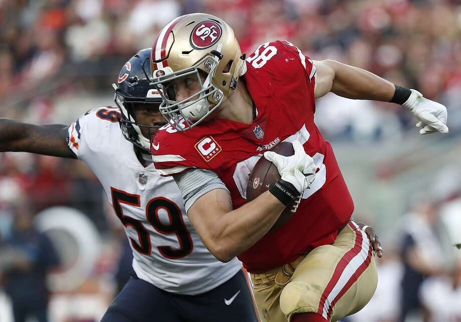 San Francisco 49ers tight end George Kittle (85) runs against Chicago Bears inside linebacker Danny Trevathan (59) during the second half of an NFL football game in Santa Clara, Calif., Sunday, Dec. 23, 2018. (AP Photo/Tony Avelar) Photo: Tony Avelar / Associated Press