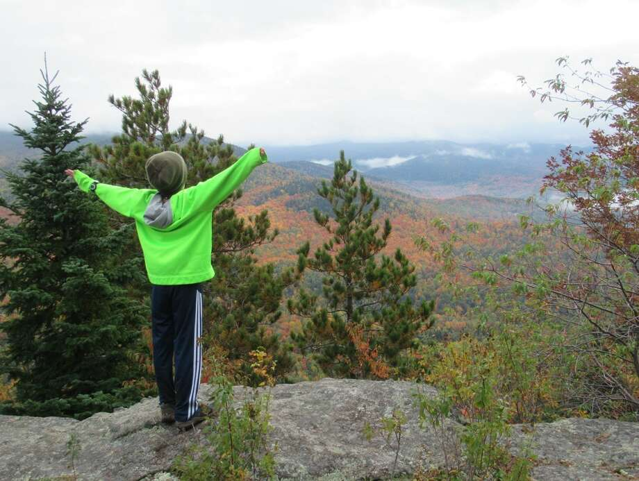 Jesse Eyer, a Clifton Park fifth-grader, and his mother recently completed the Lake Placid 9'er, a hiking challenge. Maryellen Wander Eyer says the time spent with her son deepened their connection. (Contributed photo.)