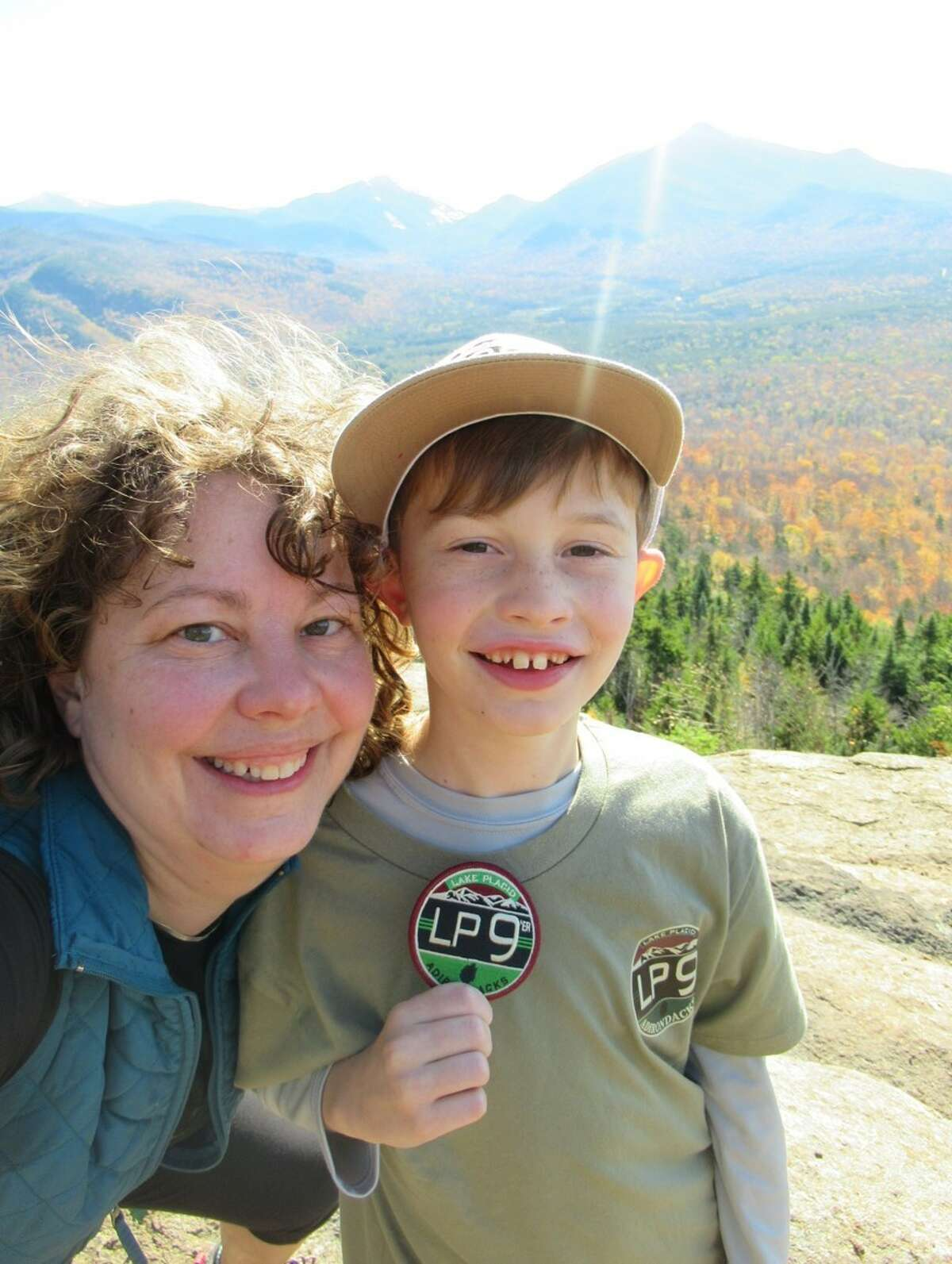 Maryellen and Jesse Eyer of Clifton Park recently completed the Lake Placid 9'er hiking challenge together. Maryellen says the time spent with her son deepened their connection. (Contributed photo.)