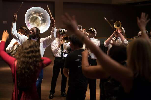 MJ's Brass Boppers marches through the crowd to finish off their concert during the Fillmore Heritage Center open house on Friday, Nov. 16, 2018, in San Francisco, Calif.