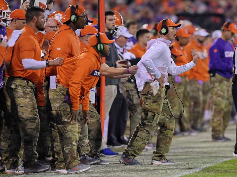 File-This Nov. 17, 2018, file photo shows, Clemson defensive coach Brent Venables being pulled back by an assistant during the first half of an NCAA college football game in Clemson, S.C. So as far as Venables is concerned, coaching defenses has always been challenging. Over 25 years in the business, the challenges have only increased as offenses have become more varied and multiple.  (AP Photo/Richard Shiro, File) Photo: Richard Shiro / Copyright 2018 The Associated Press. All rights reserved