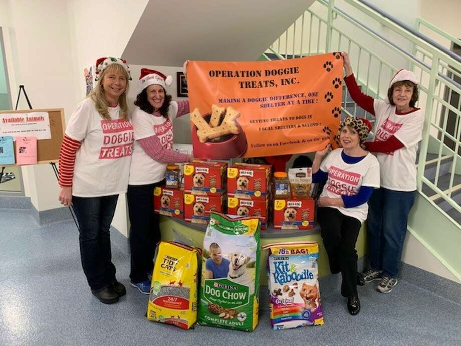 Operation Doggie Treats did it again, delivering goodies to different shelters, this year Mohawk Hudson Humane Society, Santa-style. Since  November 2016, it has brought about 3,000 pounds of treats to hungry canines. Seen are president and founder Judles Mulrooney, , Stella Collins, Mary Pressman and Joannie Hasko. (Photo provided)