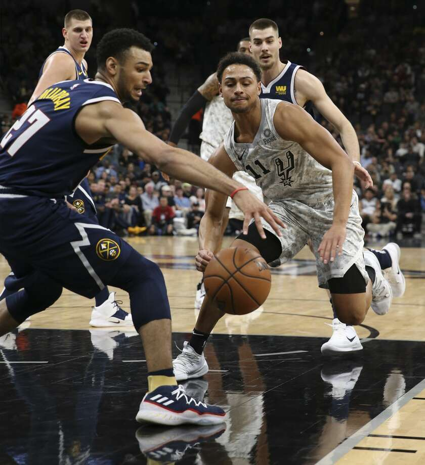 Spurs' Bryn Forbes (11) loses the ball to Denver Nuggets' Jamal Murray (27) at the AT&T Center on Wednesday, Dec. 26, 2018. (Kin Man Hui/San Antonio Express-News) Photo: Kin Man Hui/San Antonio Express-News