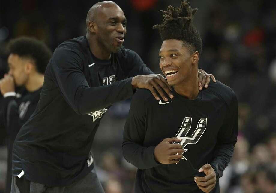 8b92d962b09 Spurs' Quincy Pondexter (left) welcomes teammate Lonnie Walker IV (right) on
