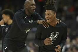 Spurs' Quincy Pondexter (left) welcomes teammate Lonnie Walker IV (right) on the floor during warm ups before the game against the Denver Nuggets at the AT&T Center on Wednesday, Dec. 26, 2018. (Kin Man Hui/San Antonio Express-News)