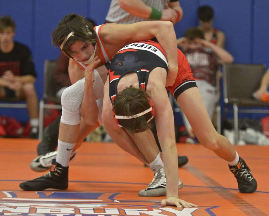 Fairfield-Warde's William Ebert (red) and Danbury's Ryan Jack (white) wrestle in the 126-pound weight class in a Dec. 19 meet. Photo: H John Voorhees III / Hearst Connecticut Media / The News-Times