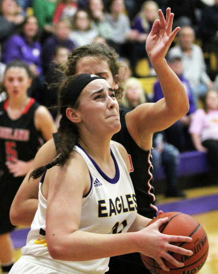 CM's Anna Hall goes to the basket after getting past Highland's Bella LaPorta in a game last week in Bethalto. Hall was in Bloomington on Wednesday and scored 24 points to lead the 15-0 Eagles to a win in the State Farm Classic. Photo: Greg Shashack / The Telegraph