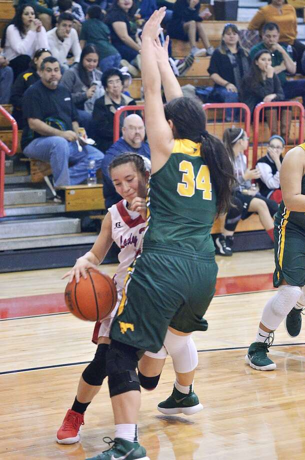 Ashley Pena and Nixon host Lexi Lopez and Martin in a rivalry rematch at 2:30 p.m. Saturday. Photo: Cuate Santos /Laredo Morning Times File / Laredo Morning Times