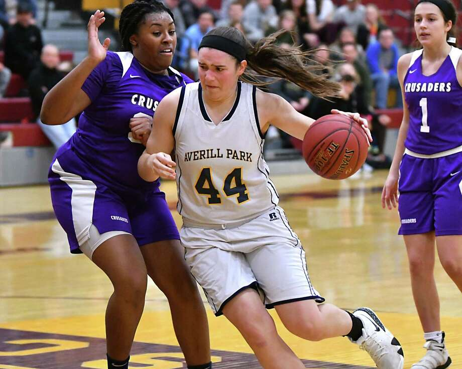 Averill Park's Olivia Kelley drives to the hoop guarded by Catholic Central High School's Riqiya Harris during a basketball game on Wednesday, Dec. 26, 2018 in Colonie, N.Y. (Lori Van Buren/Times Union) Photo: Lori Van Buren / 20045795A
