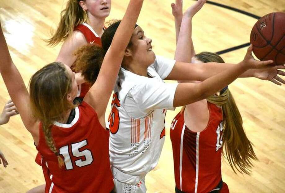 Edwardsville freshman forward Sydney Harris drives to the basket in the first quarter against Cor Jesu at the 44th annual Visitation Christmas Tournament. Photo: Matt Kamp/Intelligencer