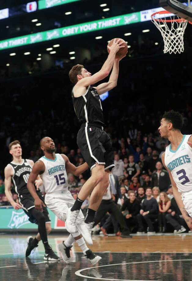 Brooklyn Nets' Joe Harris (12) drives past Charlotte Hornets' Kemba Walker (15) during the second overtime of an NBA basketball game Wednesday, Dec. 26, 2018, in New York. The Nets won 134-132. (AP Photo/Frank Franklin II) Photo: Frank Franklin II / Copyright 2018 The Associated Press. All rights reserved.