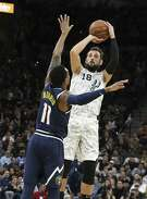 Spurs' Marco Belinelli shoots a three against Denver Nuggets' Monte Morris (11) at the AT&T Center on Wednesday, Dec. 26, 2018. (Kin Man Hui/San Antonio Express-News)