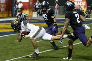 California wide receiver Kanawai Noa (9) makes a catch between TCU safety Vernon Scott (26) and safety Niko Small (2) during the first half of the Cheez-It Bowl NCAA college football game Wednesday, Dec. 26, 2018, in Phoenix. (AP Photo/Ross D. Franklin)