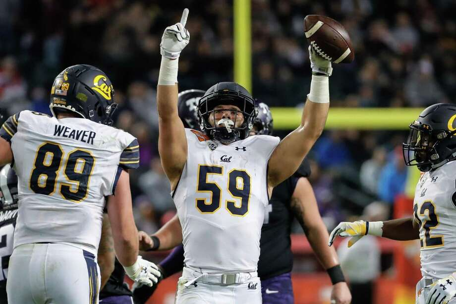 PHOENIX, AZ - DECEMBER 26: California Golden Bears linebacker Jordan Kunaszyk (59) celebrates an interception during the Cheez-It Bowl between the California Golden Bears and the TCU Horned Frogs on December 26, 2018 at Chase Field in Phoenix, Arizona. (Photo by Kevin Abele/Icon Sportswire via Getty Images) Photo: Icon Sportswire / Icon Sportswire Via Getty Images / ©Icon Sportswire (A Division of XML Team Solutions) All Rights Reserved