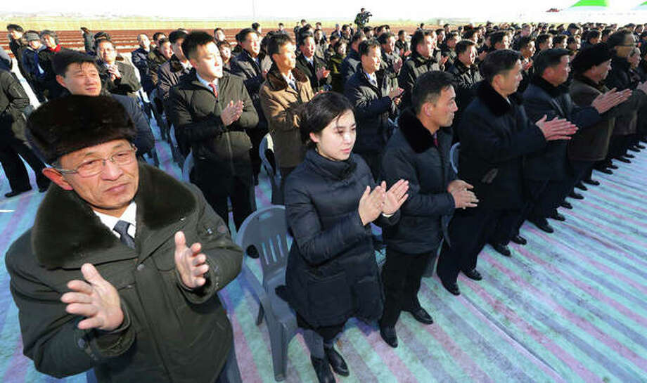 North Koreans applaud during a groundbreaking ceremony at Panmun Station in Kaesong, North Korea, on Wednesday. North and South Korea broke ground on an ambitious project to modernize North Korean railways and roads and connect them with the South, but without progress in nuclear negotiations, regular trains won't be crossing the border anytime soon. Korea Pool | Newsis (via AP)