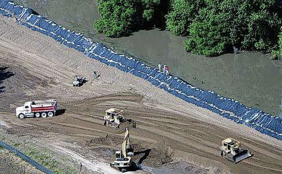 Crews check out the 54-mile-long Sny Levee that protects 125,000 acres of prime farmland as the Mississippi River continues to rise south of Quincy. Some Missouri landowners as well as environmentalists are urging the Federal Emergency Management Agency to take sanctions against the Sny Island Levee District in Illinois for raising its levee to unauthorized heights. The Missourians say the too-high levee worsens flooding on their side of the river. Photo: M. Spencer Green   AP