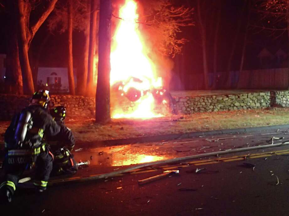 The driver of a car escaped from their vehicle before it burst into flames on Wilton Road in Westport early Thursday, Dec. 27, 2018. Photo: Westport Fire Department Photo