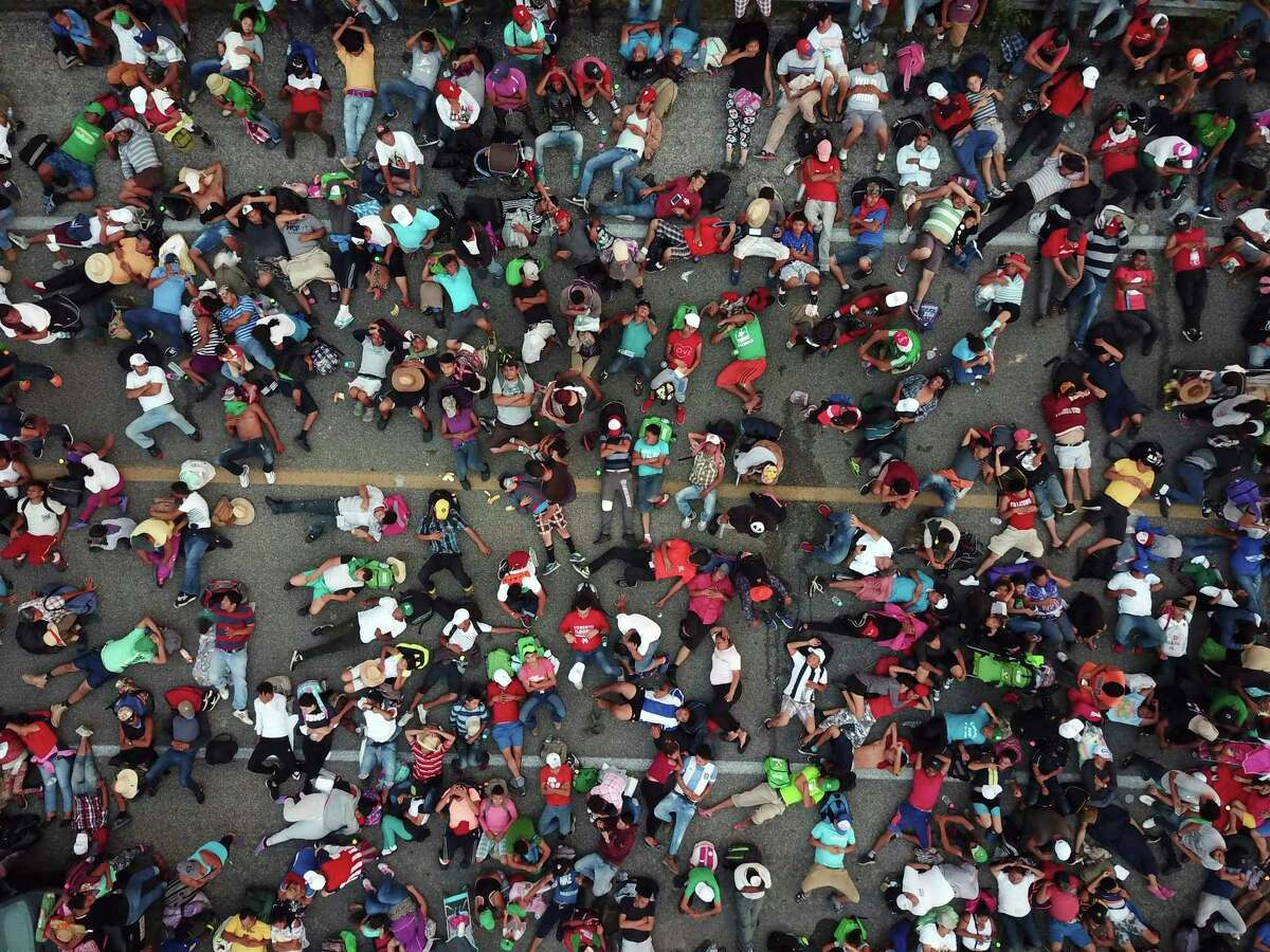 Members of a U.S.-bound migrant caravan cross a bridge between the Mexican states of Chiapas and Oaxaca after federal police briefly blocked them outside the town of Arriaga, Saturday, Oct. 27, 2018.