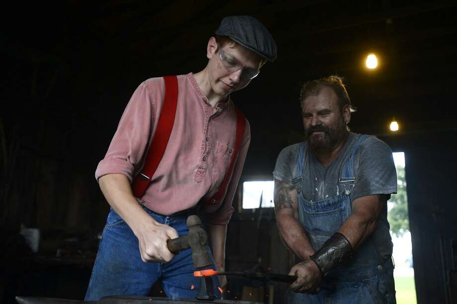 Joe Dannar hammers a wrench while blacksmith Rob Flurry holds it still during a bladesmithing class at the Spindletop-Gladys City Boomtown Museum on Saturday. Dannar is building his own forge at his house.  Photo taken Saturday 9/24/16 Ryan Pelham/The Enterprise Photo: Ryan Pelham / Ryan Pelham/The Enterprise / ©2016 The Beaumont Enterprise/Ryan Pelham