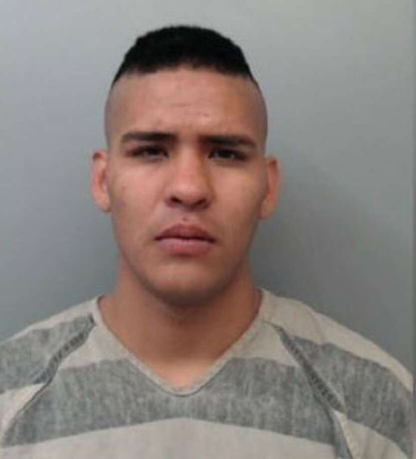 Samuel Enrique Gomez, 22, was charged with theft of property and burglary of a vehicle. Photo: Webb County Sheriff's Office